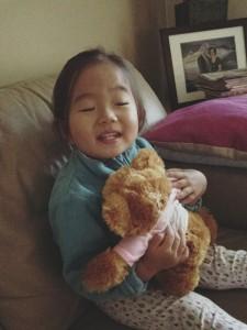 Naomi cuddling 'mummy-daddy bear'